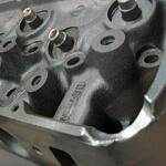 Typical cast cylinder head (427) damage due to mishandling.
